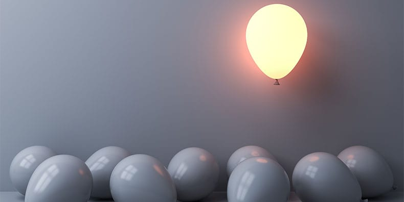glowing balloon floats above deflated gray balloons representing bipolar disorder worry rumination relapse