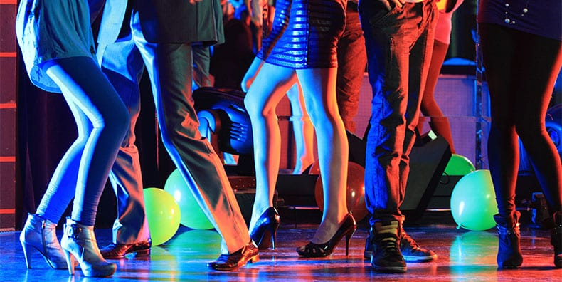A group of people are out dancing at night, representing one way to get a safe rush while staying stable and med-compliant with bipolar.