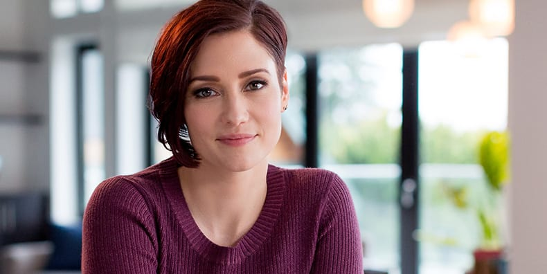 Actress and advocate for bipolar Chyler Leigh, currently starring on the CW's Supergirl, smiles gently at the camera. She opens up about her bipolar diagnosis, symptoms, and advocacy with Be Vocal: Speak Up for Mental Health to spread awareness and empowerment to the community.