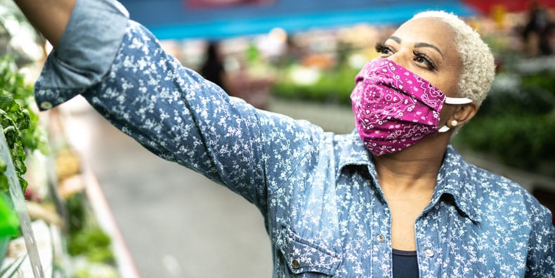 woman-BIPOC-grocery-shopping-wearing-mask-anxiety-public-bipolar-disorder-breathing-strategies